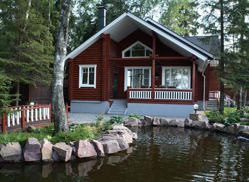 Lesena hiša ob ribniku
